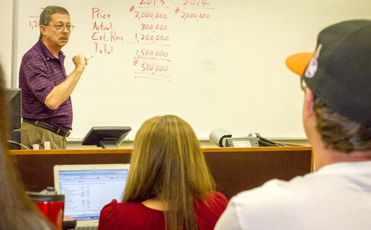 Professor Gene Johnson instructs an accounting class